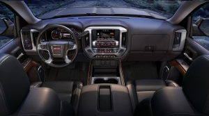 The interior on the 2015 GMC Sierra SLT has an upright instrument panel with clear, easy to use controls.